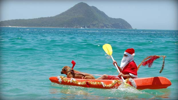 santa-in-canoe